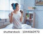 asian women are listening to...   Shutterstock . vector #1044060970
