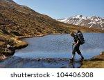 Woman Trekking In Mountain