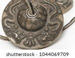 tibetan buddhist tingsha cymbal ... | Shutterstock . vector #1044069709