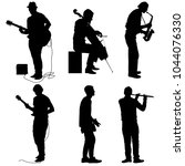 silhouettes street musicians...   Shutterstock .eps vector #1044076330