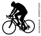 silhouette of a cyclist male on ... | Shutterstock .eps vector #1044076354