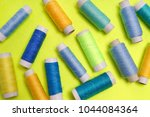 blue and yellow sewing thread | Shutterstock . vector #1044084364