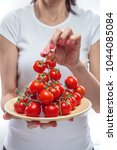 ripe cherry tomatoes with...   Shutterstock . vector #1044085084