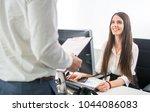 beautiful smiling secretary... | Shutterstock . vector #1044086083