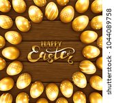 set of golden easter eggs with... | Shutterstock .eps vector #1044089758