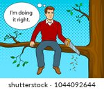 man sawing tree branch on which ... | Shutterstock .eps vector #1044092644