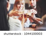 hands of people with glasses of ... | Shutterstock . vector #1044100003