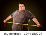 man belly fat with tape measure ... | Shutterstock . vector #1044100729