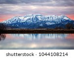 snowy scene with mount... | Shutterstock . vector #1044108214
