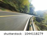 woodland mountain road | Shutterstock . vector #1044118279