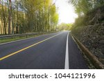 woodland mountain road | Shutterstock . vector #1044121996