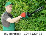 gardener at gardening in the... | Shutterstock . vector #1044123478