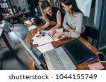 team of female interior... | Shutterstock . vector #1044155749