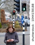 Young Woman Crossing The Stree...
