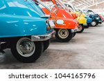 vintage cars parking in a row.... | Shutterstock . vector #1044165796