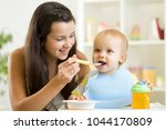 mommy giving healthy food to... | Shutterstock . vector #1044170809