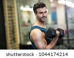 man exercising in gym | Shutterstock . vector #1044174214