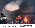 cauldron on fire. cast iron old.... | Shutterstock . vector #1044177079