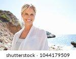 joyful portrait of beautiful... | Shutterstock . vector #1044179509