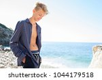 young man relaxing walking on... | Shutterstock . vector #1044179518