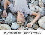 portrait of an attractive... | Shutterstock . vector #1044179530