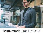 disgruntled proud ceo dressed... | Shutterstock . vector #1044193510
