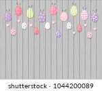 colorful easter eggs hanging on ...   Shutterstock .eps vector #1044200089