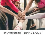 group of diverse women put... | Shutterstock . vector #1044217273