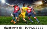 stadium in the evening in full... | Shutterstock . vector #1044218386