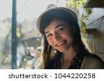 portrait of a young woman with...   Shutterstock . vector #1044220258