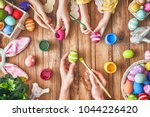 a mother  father and their...   Shutterstock . vector #1044226420
