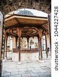 Small photo of SARAJEVO, BOSNIA AND HERZEGOVINA - March 2018: The fountain in the courtyard of Gazi Husrev-beg Mosque in old town of Sarajevo, Bosnia and Herzegovina