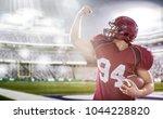 american football player... | Shutterstock . vector #1044228820