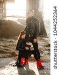 red haired girl hugging a guy... | Shutterstock . vector #1044252364