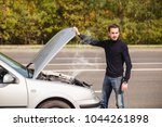 a man tries to repair the car... | Shutterstock . vector #1044261898