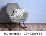 armchair with soft pillow near... | Shutterstock . vector #1044269653