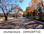 autumn season on the road in... | Shutterstock . vector #1044269710