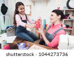 mom and daughter work together... | Shutterstock . vector #1044273736