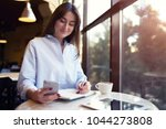 young business woman in a blue... | Shutterstock . vector #1044273808