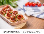 bruschettas with sun dried... | Shutterstock . vector #1044276793