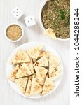 Small photo of Homemade sesame pita chips with roasted eggplant dip or spread, baba ganoush in the Mediterranean cuisine on the side, photographed overhead with natural light