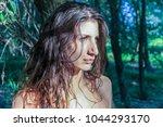 beautiful pagan woman looking... | Shutterstock . vector #1044293170