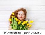 little girl with bouquet of... | Shutterstock . vector #1044293350
