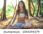 pagan girl resting in the... | Shutterstock . vector #1044294379