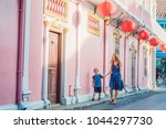 mom and son are tourists on the ... | Shutterstock . vector #1044297730