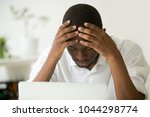 frustrated african businessman... | Shutterstock . vector #1044298774