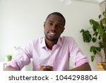african american man talking... | Shutterstock . vector #1044298804