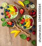 green smoothie in bowls for... | Shutterstock . vector #1044300064
