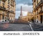 small paris street with view on ... | Shutterstock . vector #1044301576