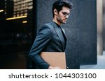 confident young businessman... | Shutterstock . vector #1044303100
